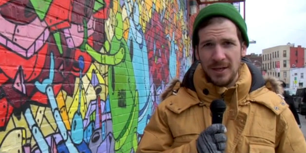 Reporter standing in front of colorful graffiti